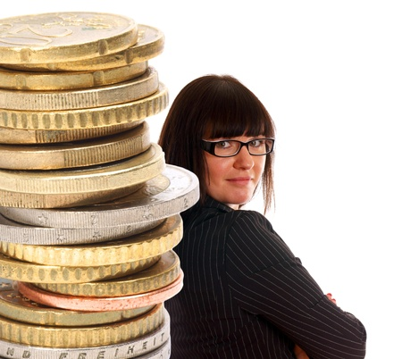 business woman and a stack of coins photo