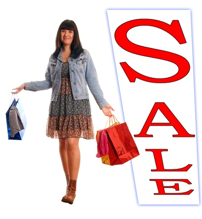 woman with shopping bags and a sign with the word Sale photo