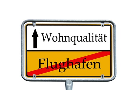 sign with the german words quality of living and airport photo