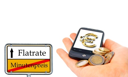 hand with smartphone and sign with the german words flatrate and minutes price photo