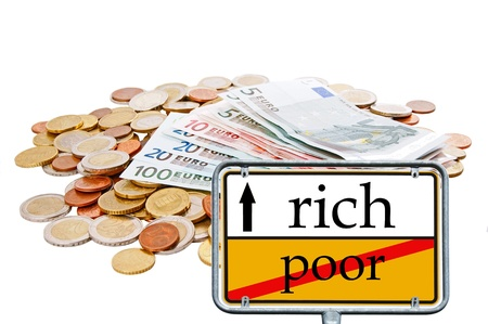 euro money and sign with the words rich and poor Stock Photo - 14458756