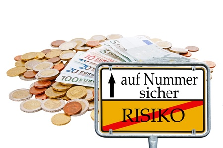 hedged: euro money and sign with the german words risk and number to ensure