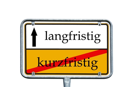 long term: sign with the german words long term and short term