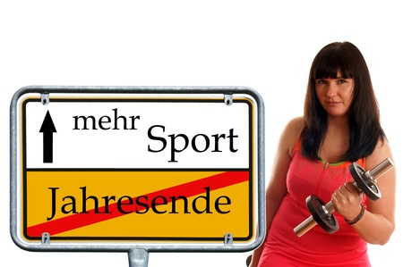 sporty woman with sign and german words old year and more sports photo