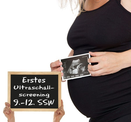 pregnant woman with a ultrasound image and sign with german words photo