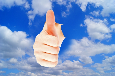 woman handle success: blue sky with clouds and thumbs up