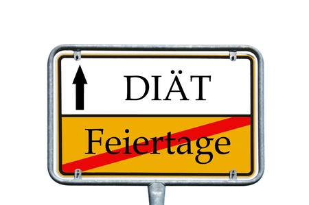 sign with the german words Diet and Holidays photo