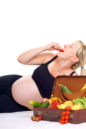 pregnant woman with healthy fruit and vegetables photo