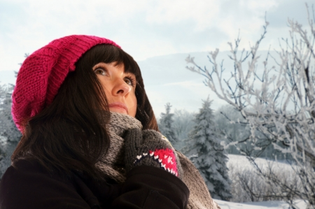 woman in winter clothes and winter landscape photo