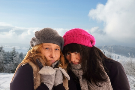 two woman in winter clothes and winter landscape Stock Photo - 14605687