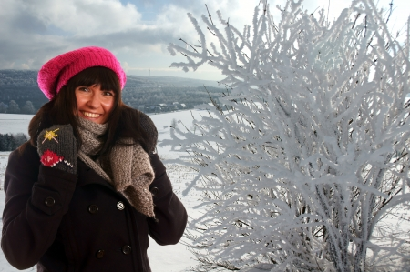 woman in winter clothes and winter landscape Stock Photo - 14605689