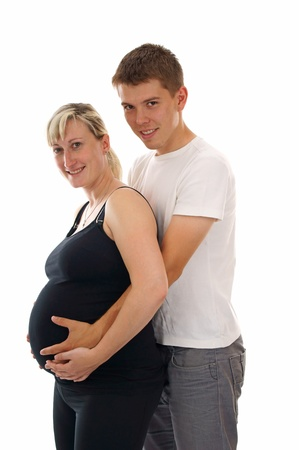 Man holding the belly of his pregnant wife photo