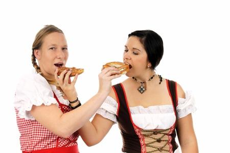 guild: two pretty women in dirndls and pretzels
