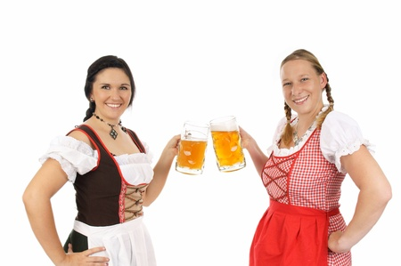 Two young pretty women in dirndl with beer mug photo