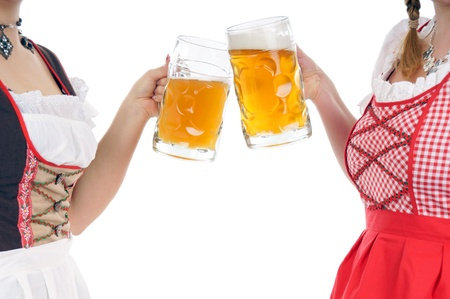 Two young pretty women in dirndl with beer mug Stock Photo - 14933340