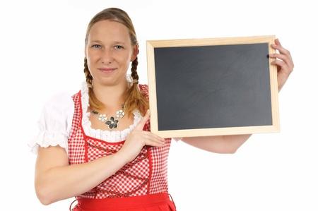pretty woman in dirndl with empty billboard photo