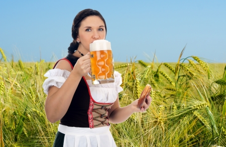 pretty woman in dirndl and Pint photo