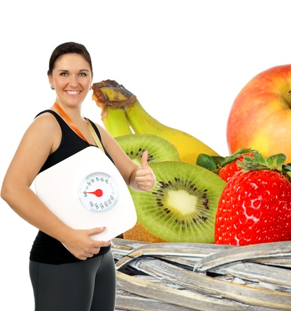 desired: young woman with a weight scale and fresh fruit