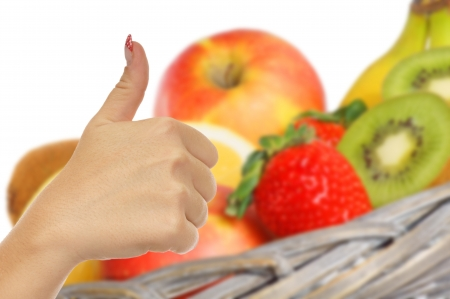 thumbs up and fresh fruits photo