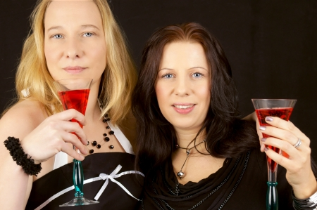 two pretty woman with champagne glass photo