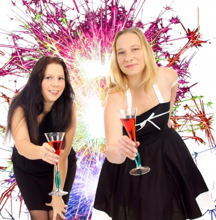 jahreswechsel: two pretty women with champagne glass