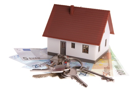small house with bills and house keys photo