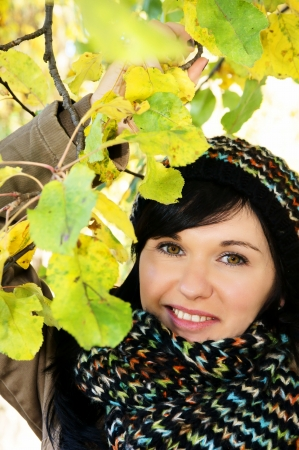Beautiful woman in autumn forrest Stock Photo - 16013775