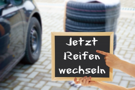 sign with the german words Now change tires