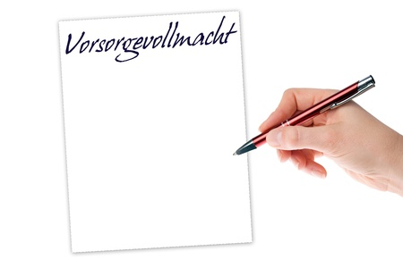 durable: Hand with pen writing the german words Durable power of attorney