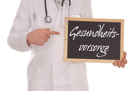 Doctor and sign with the german words health care photo