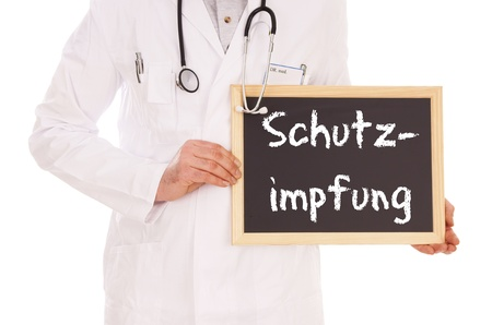 diphtheria: Doctor and sign with the german word vaccination