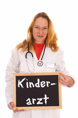 female Doctor and sign with the german words pediatrician photo