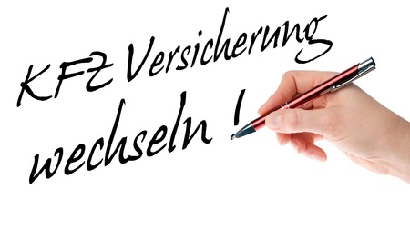 fully comprehensive: Hand with pen writes the german words Car Insurance Change