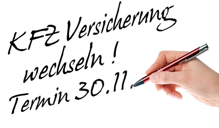 fully comprehensive: Hand with pen writes the german words Car Insurance Change Date 30 11