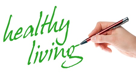 hand with pen writes the words healthy living Stock Photo - 16655690
