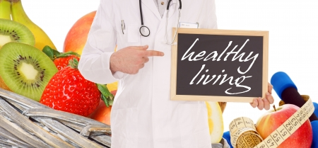 preventive medicine: fresh fruit and doctor with sign - healthy living Stock Photo