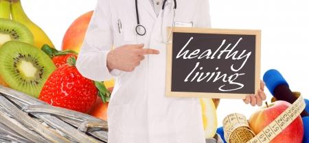 nutrici�n: fruta fresca y el m�dico con el signo - una vida saludable Foto de archivo