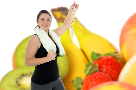 sporty woman and fresh fruits photo