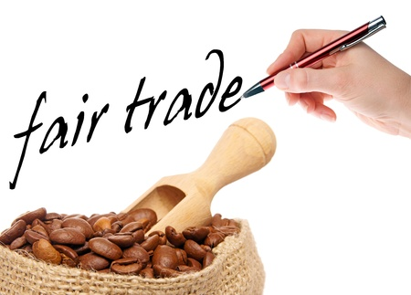 coffee beans with hand writes fair trade Stock Photo