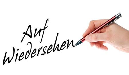 amabilidad: Mano con la pluma escribe las palabras alemanas adi�s