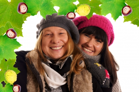 Two young woman in winter clothes photo