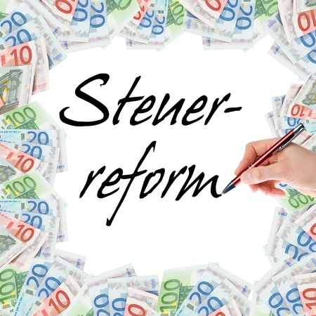 wage earner: Hand with pen writes the german words tax Reform