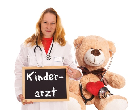 Doctor with teddy bear and sign with the german words Pediatrician photo