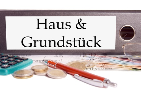 homeowners insurance: file folder with the german words House and grounds