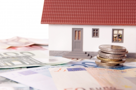 small house with euro banknotes and euro coins Stock Photo - 17071034