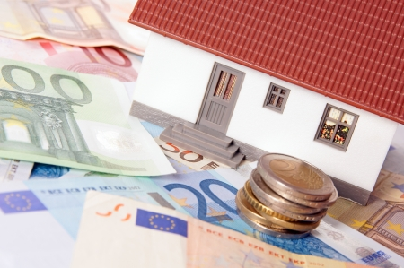 small house with euro banknotes and euro coins photo