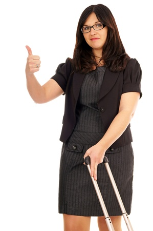 Business woman with suitcase and thumbs up photo