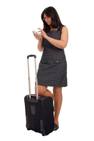 Business woman with suitcase and mobile phone photo