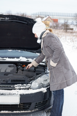 engine compartment: Car break - woman looks into the engine compartment Stock Photo