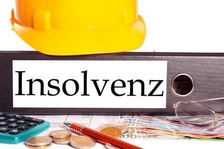 insolvency: Hard Hat and file folder with the german word insolvency